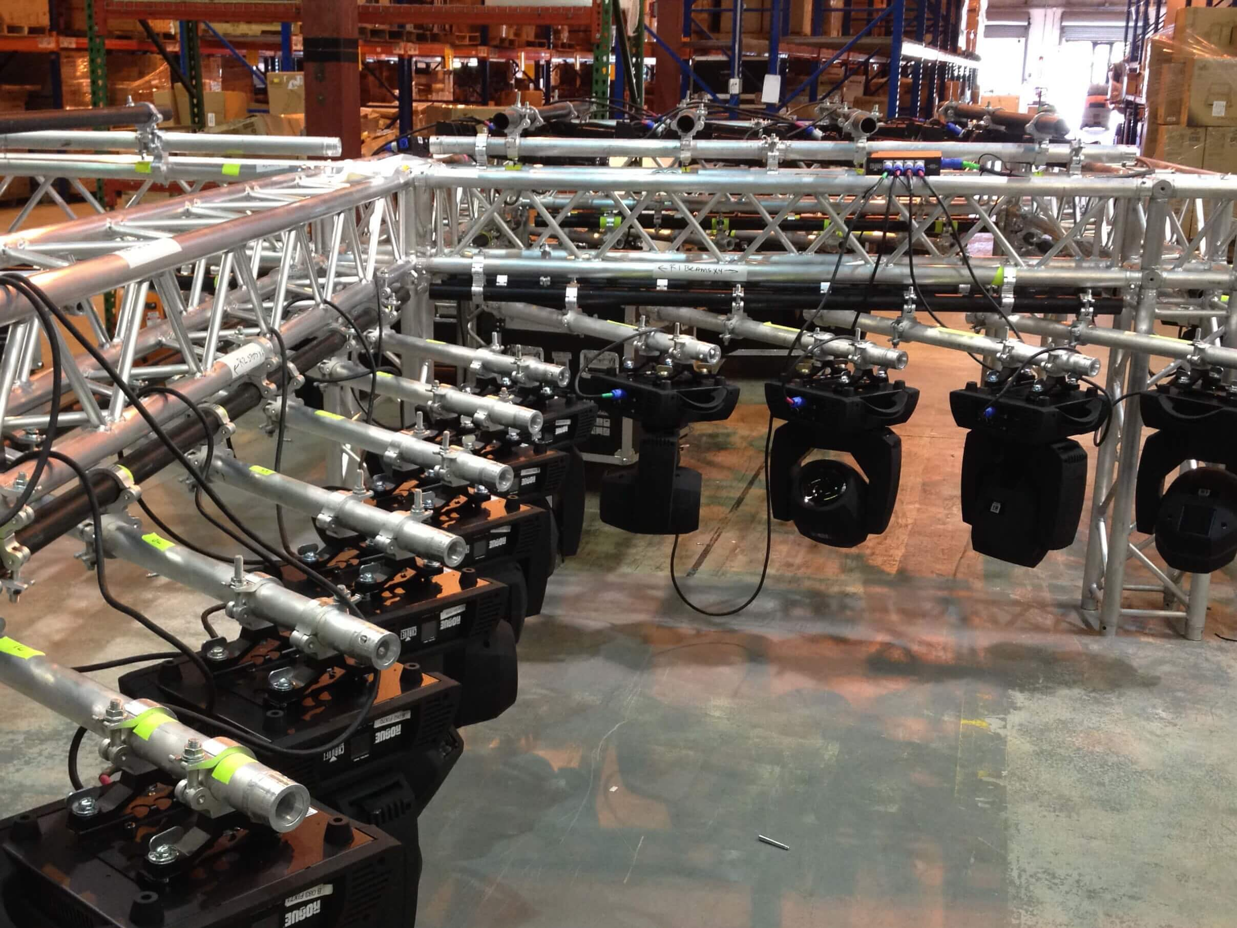 Lights hanging off a ceiling rig waiting to be installed